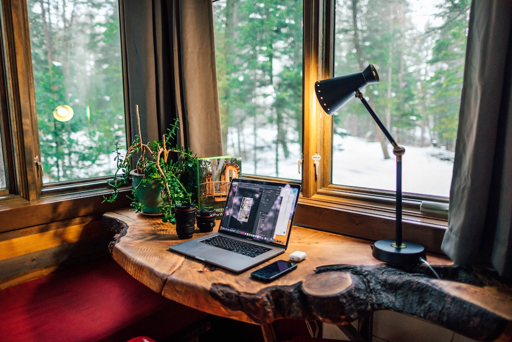 work from home desk in the forest view of trees